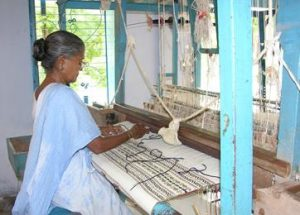fibre is hand woven into cloth using big looms.