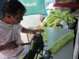 Rajubhai the tailor creates organic shirts for Where Does It Come From? shirt production wheredoesitcomefrom.co.uk