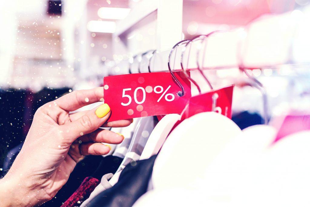 clothes sale) Photo by Artem Beliaikin on Unsplash